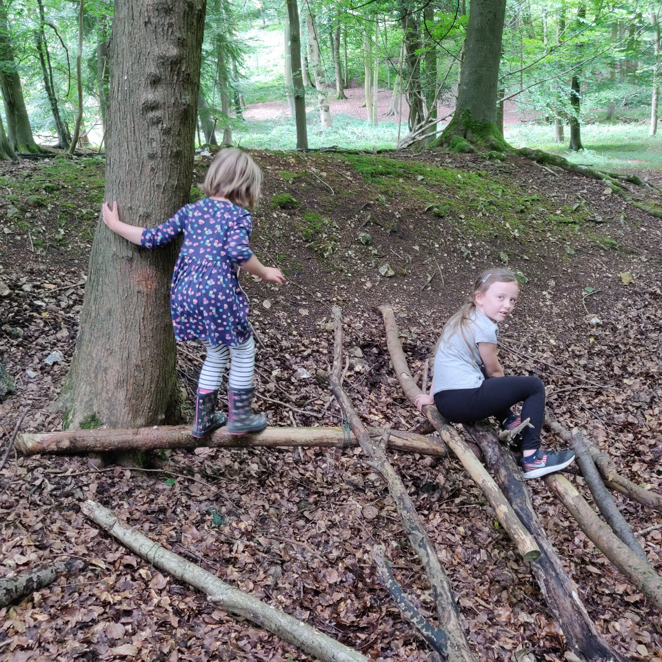 Children learning about den building and interacting with nature.